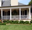 round wooden porch columns